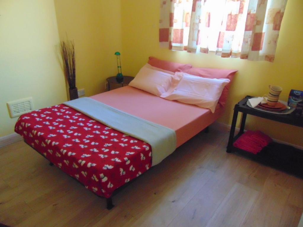 A bed or beds in a room at HOUSE OF ADA