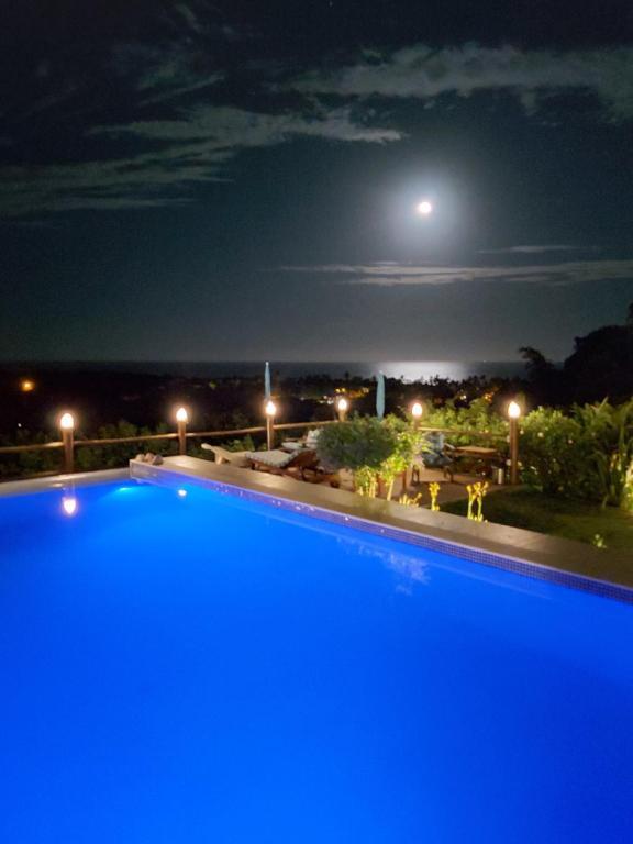 A piscina localizada em Pousada Mar à Vista ou nos arredores