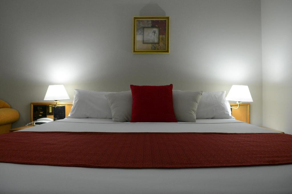 A bed or beds in a room at Club Inn Motel