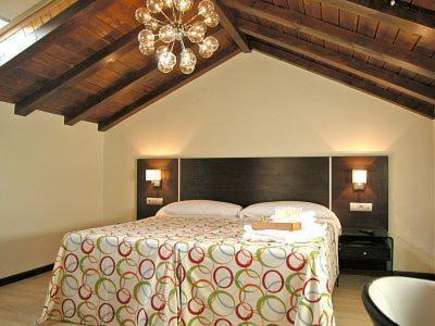 Cama o camas de una habitación en Casa Rural La Prensa de Vino