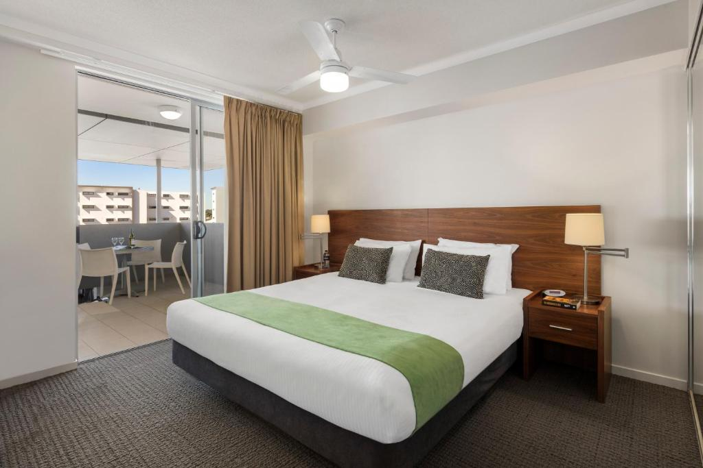 A bed or beds in a room at Quest Chermside