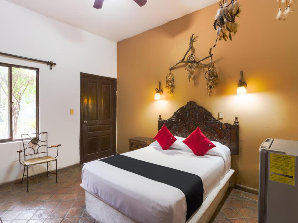 A bed or beds in a room at Hotel Olimpia