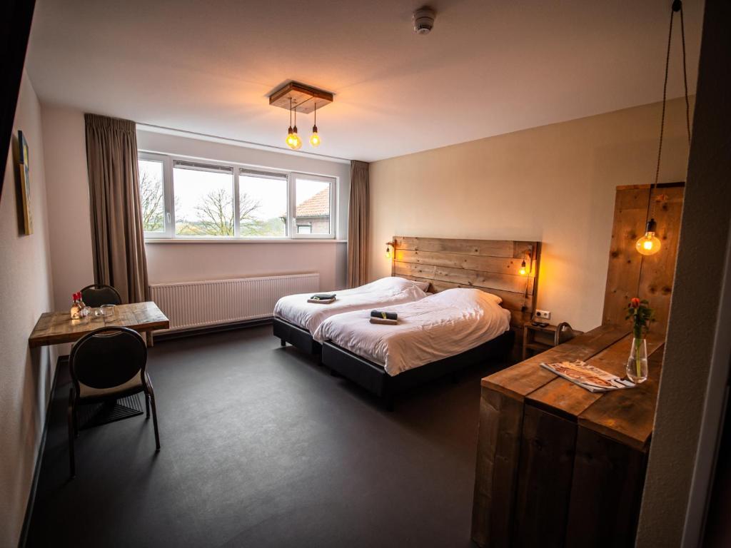 Een bed of bedden in een kamer bij B&B bij de 3 linden
