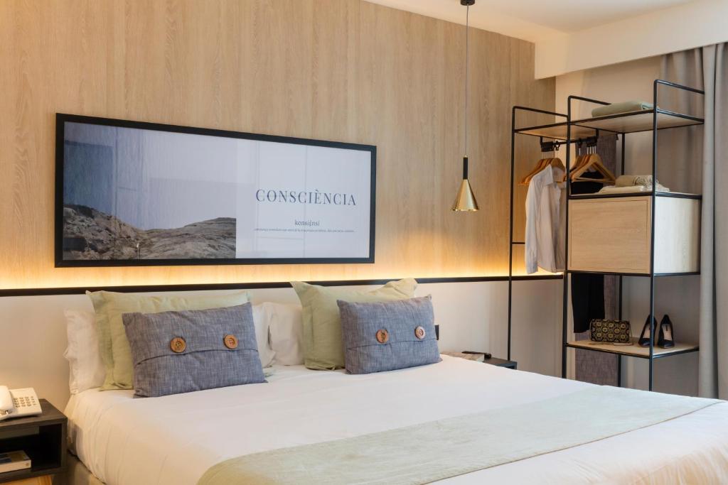 Säng eller sängar i ett rum på Ars Magna Bleisure Hotel