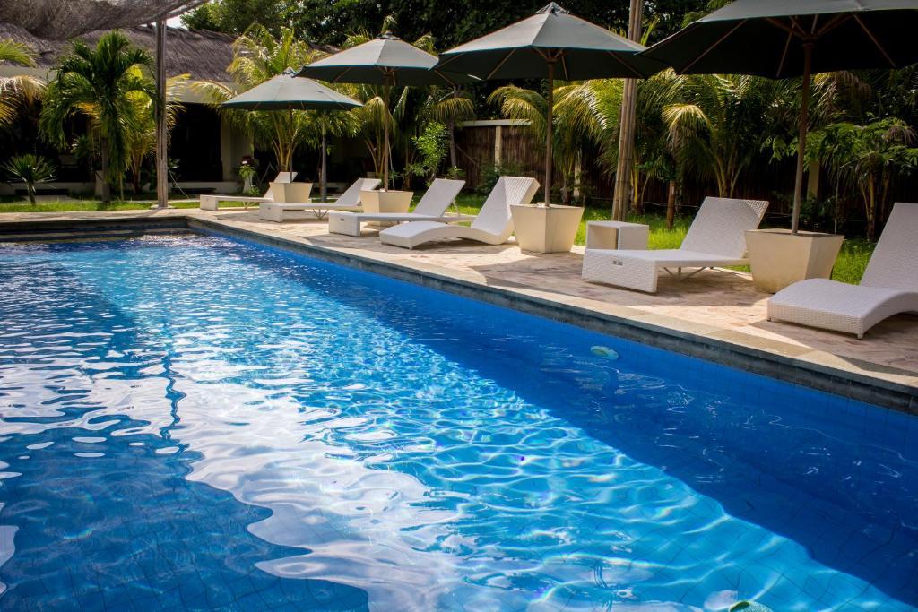 The swimming pool at or near Kaluku Gili Resort
