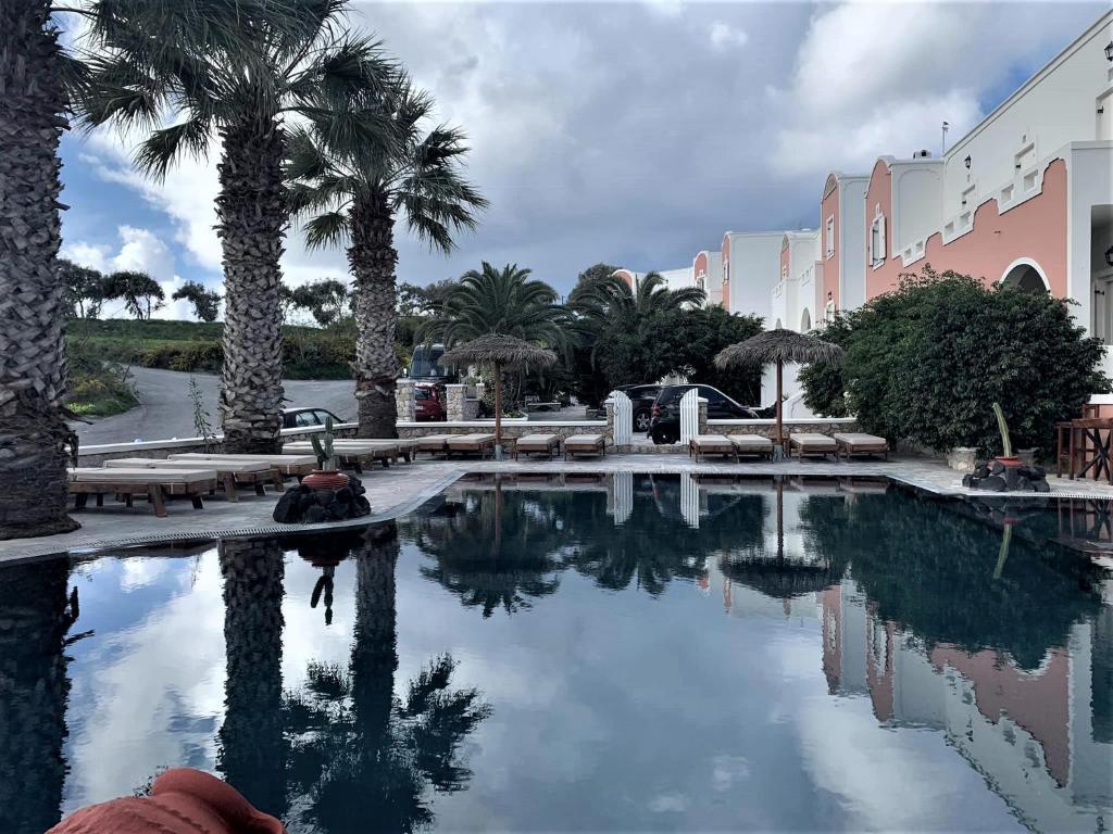 The swimming pool at or near Villa Manos Hotel