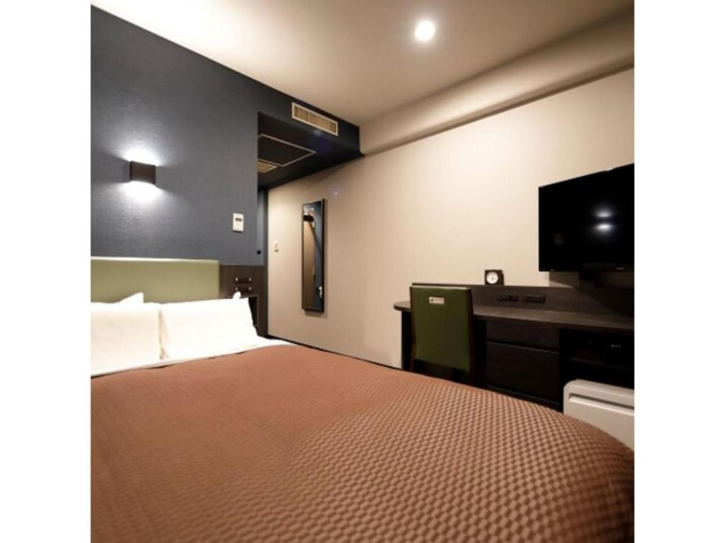 A bed or beds in a room at Kawasaki Daiichi Hotel Mizonokuchi / Vacation STAY 78148