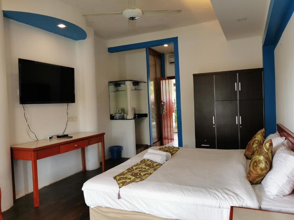A bed or beds in a room at Panorama country langkawi
