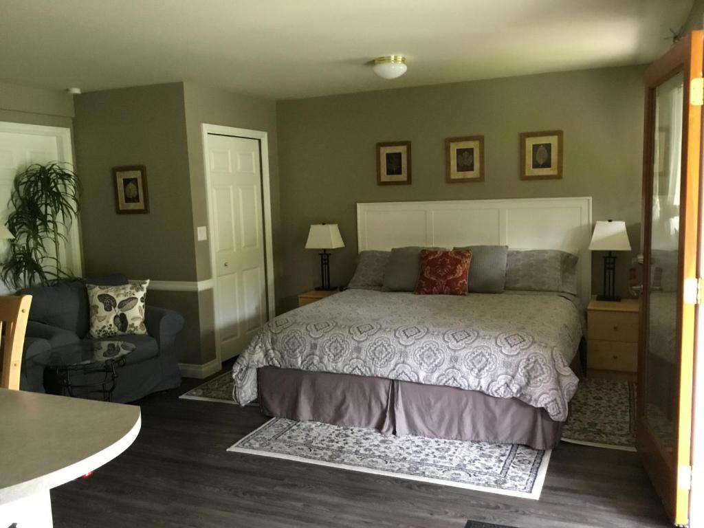 A bed or beds in a room at Nestledown B&B