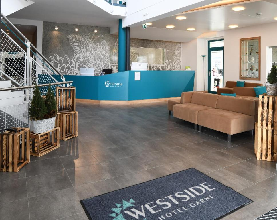The lobby or reception area at WESTSIDE Hotel