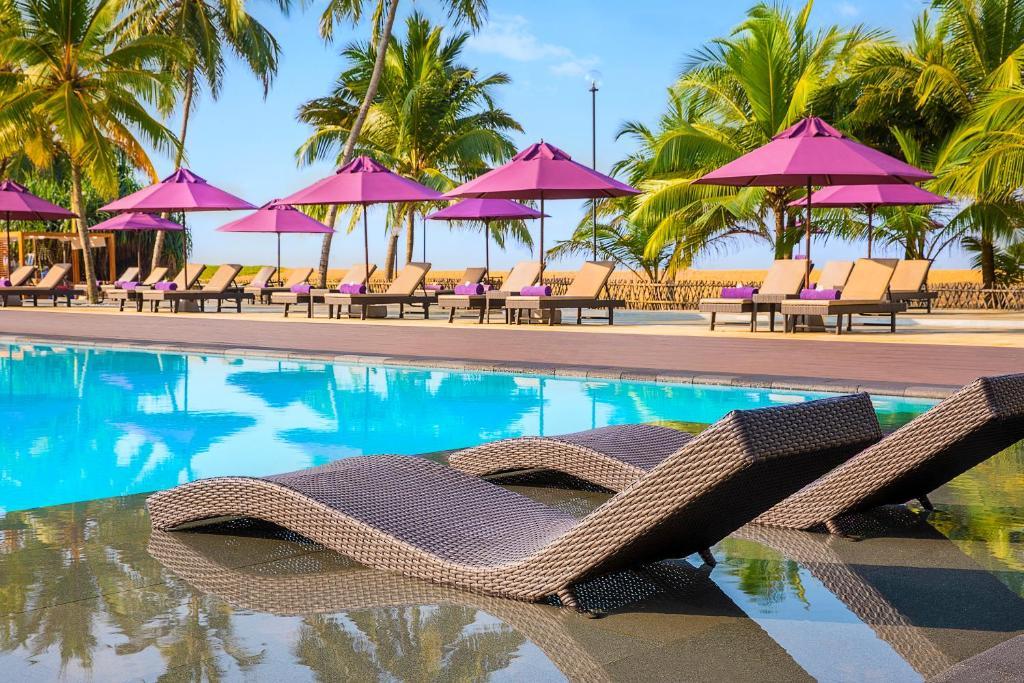 The swimming pool at or near Avani Kalutara Resort