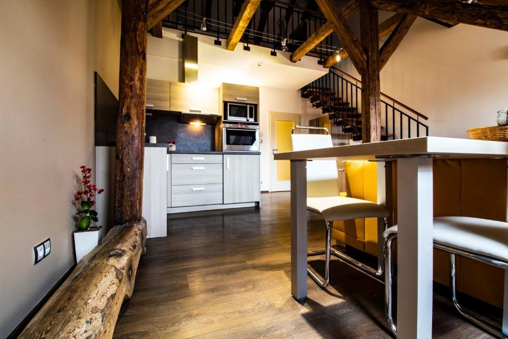 A kitchen or kitchenette at Residence U Černé Věže České Budějovice