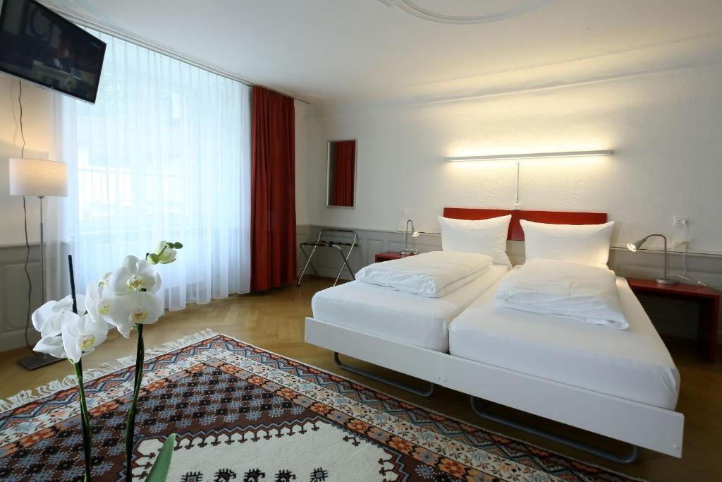 Ein Bett oder Betten in einem Zimmer der Unterkunft Hotel Roter Ochsen