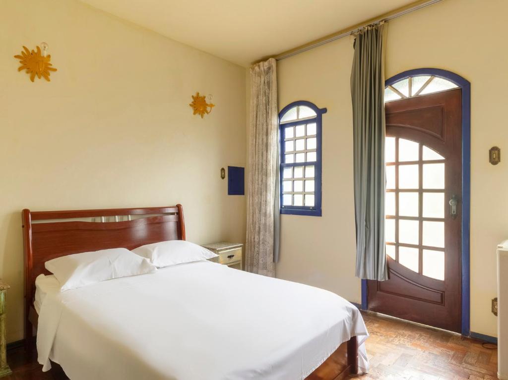 Giường trong phòng chung tại Pousada Morada Do Sol mg