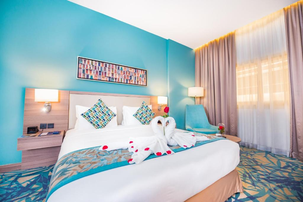 A bed or beds in a room at MENA Plaza Hotel Albarsha