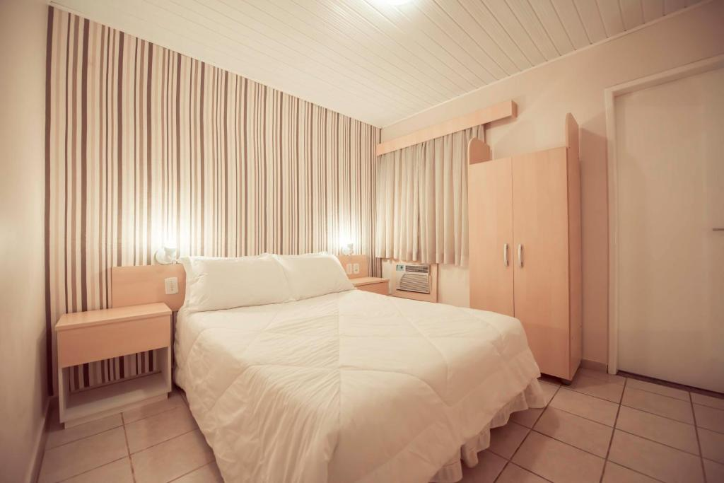 A bed or beds in a room at Hotel Treviso