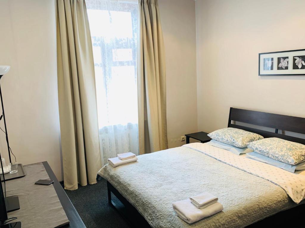Кровать или кровати в номере ИЛИАН Хостел