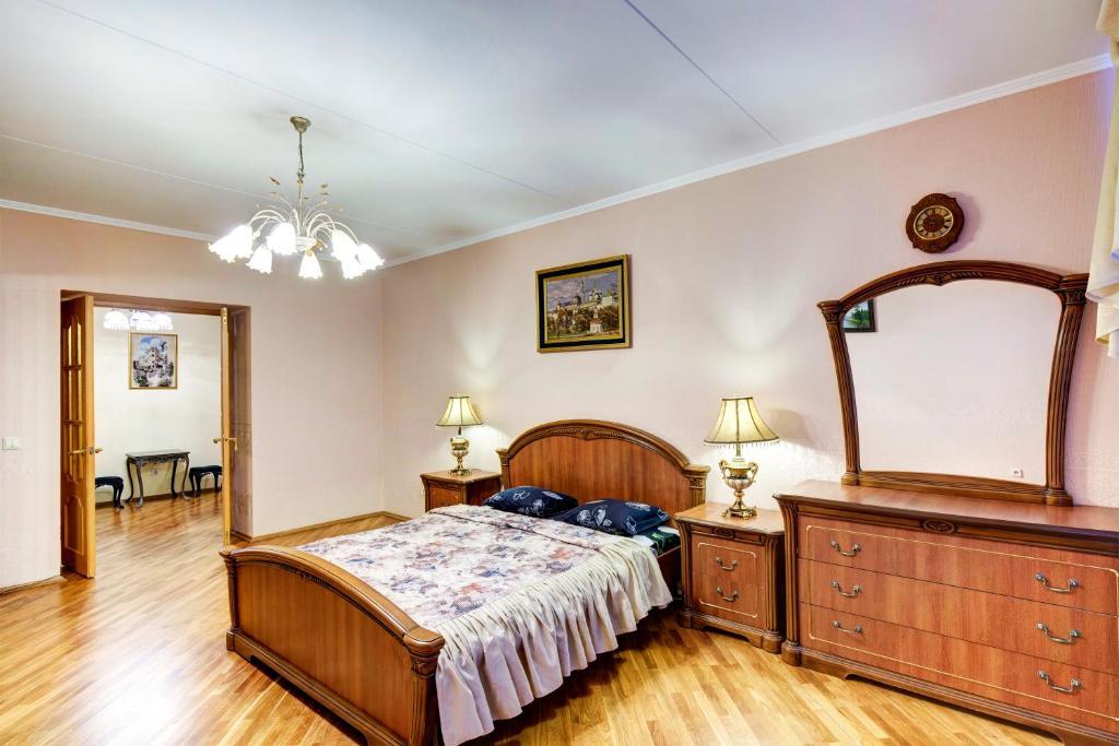 Кровать или кровати в номере Тверитина DreamHouse Апарт с сауной