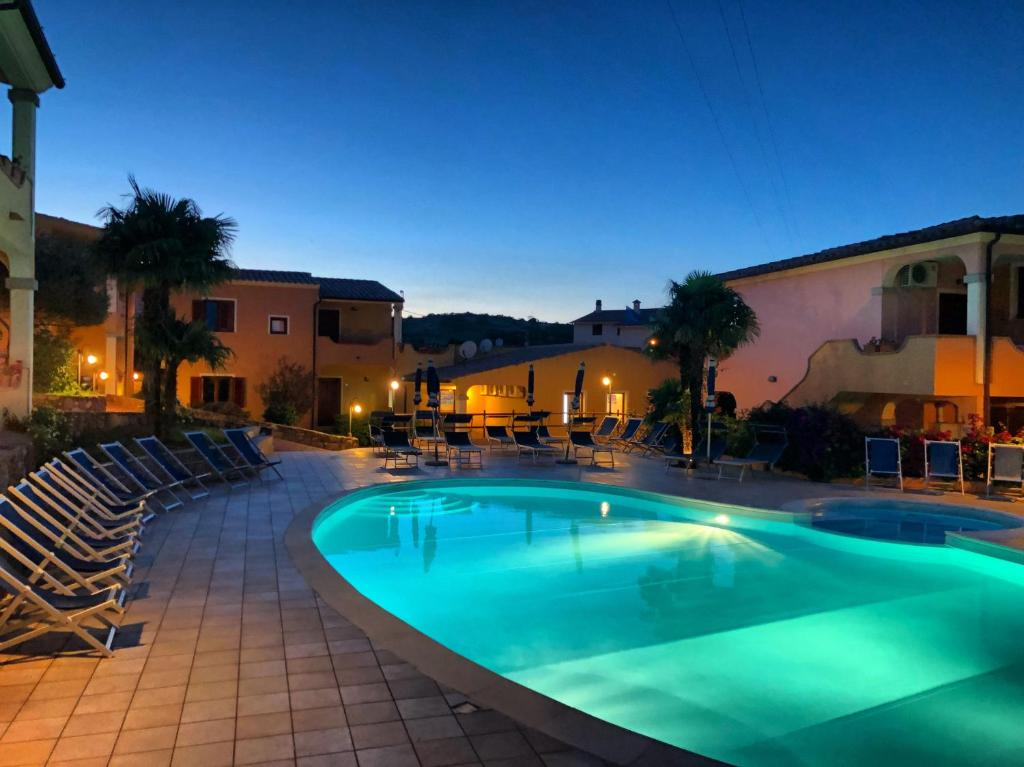 The swimming pool at or near Residence Corte Dei Venti