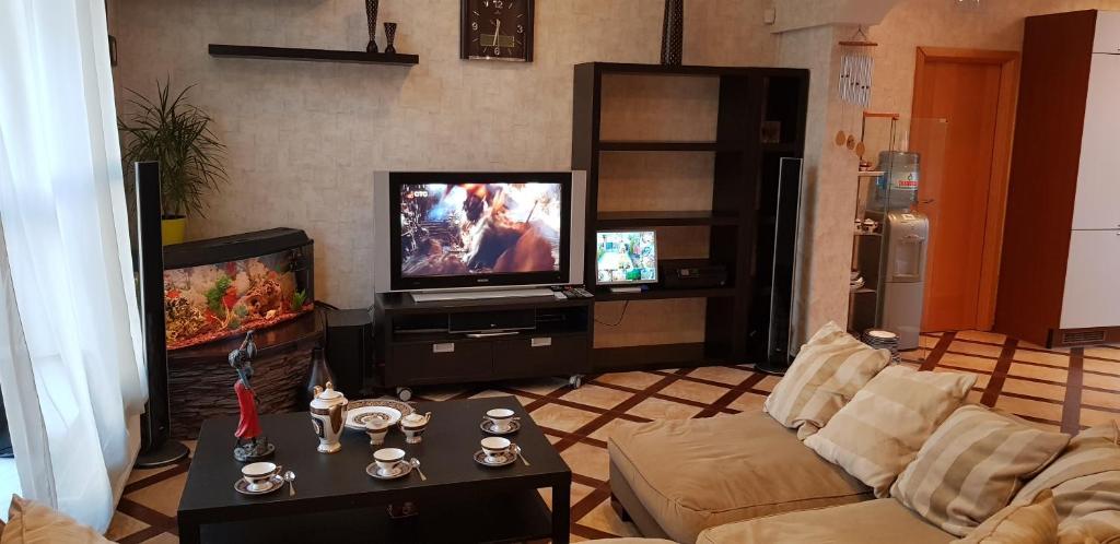 A television and/or entertainment centre at Загородный Дом-Шале на Рублевке