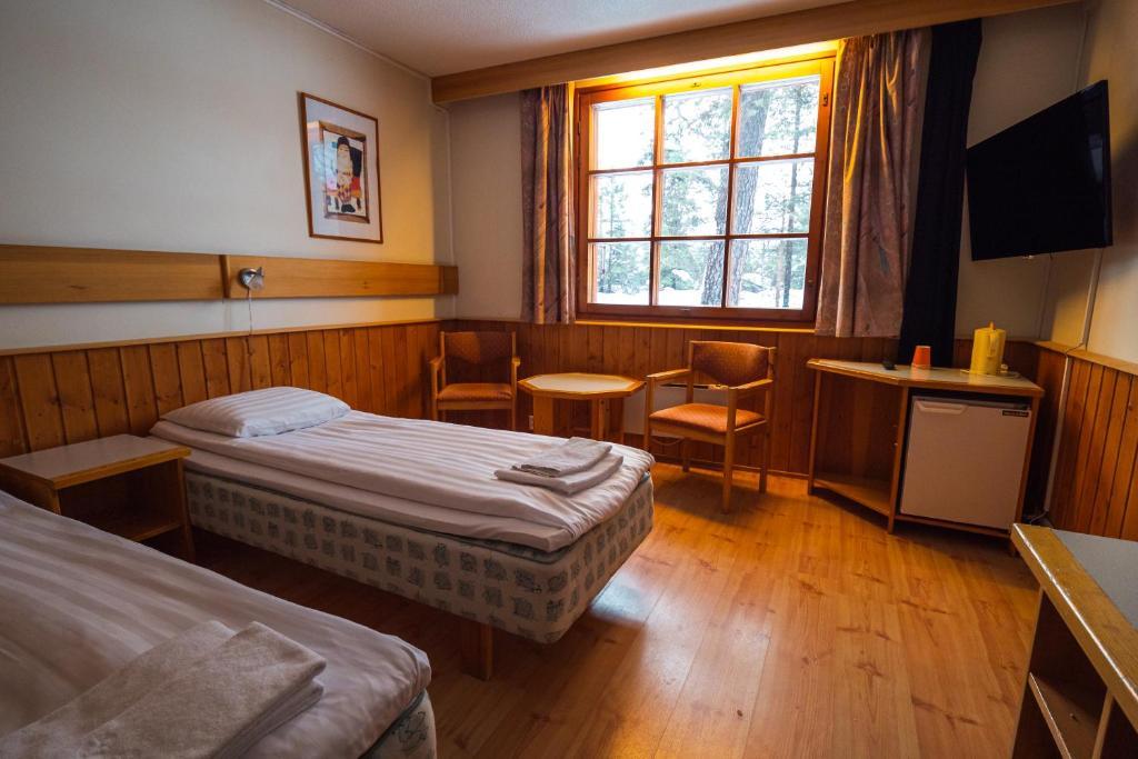 Vuode tai vuoteita majoituspaikassa Saariselkä Inn Majatalo Panimo