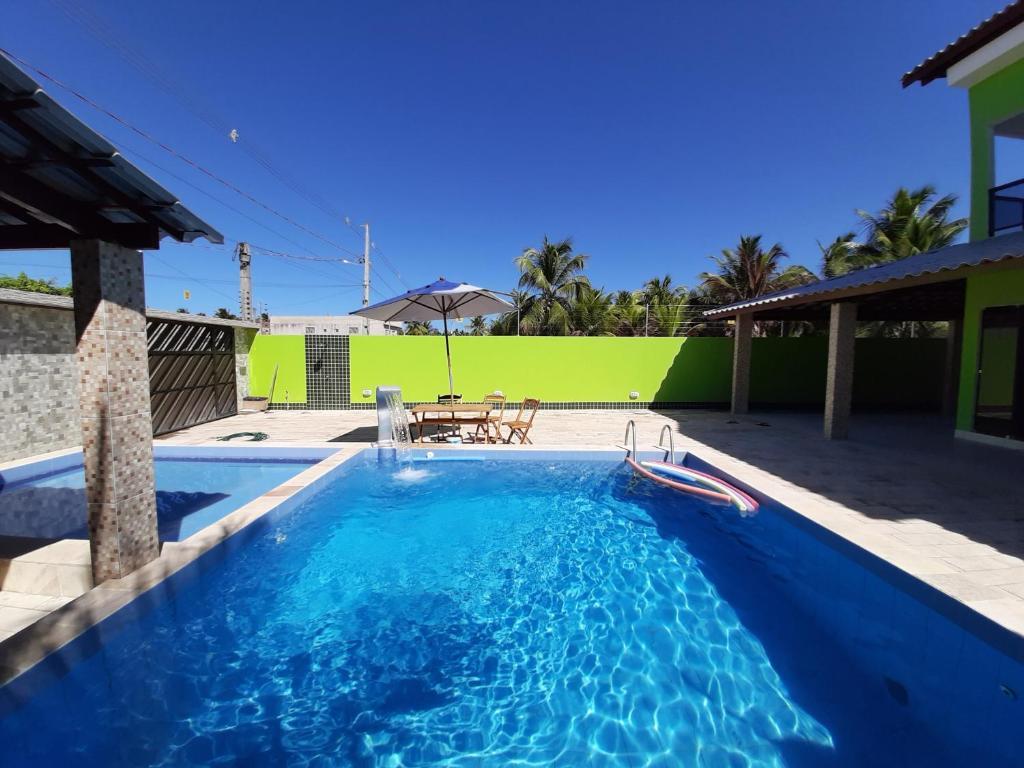 The swimming pool at or near Beach House Maragogi