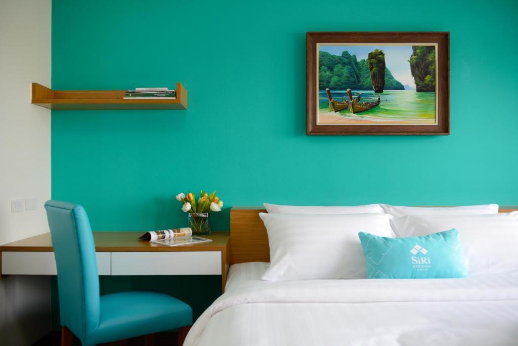 A bed or beds in a room at SiRi Ratchada Bangkok