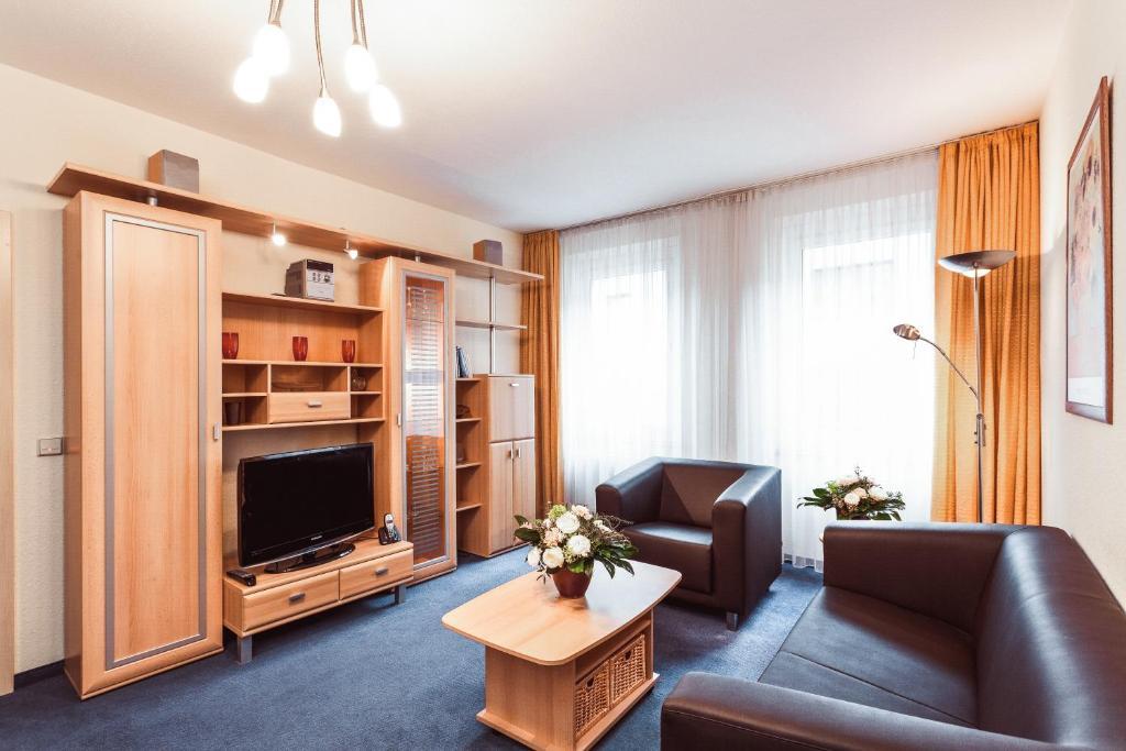 Ein Sitzbereich in der Unterkunft Aparthotels Münzgasse An der Frauenkirche