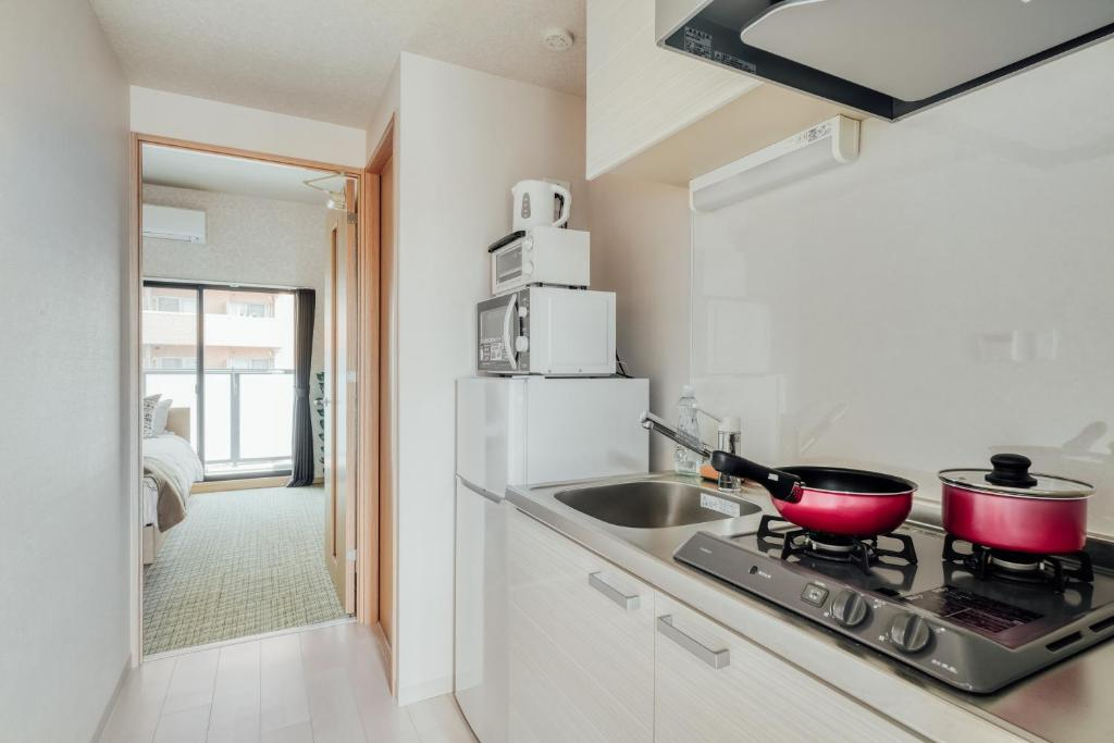 A kitchen or kitchenette at ALZA Fukushima AFP Apartment