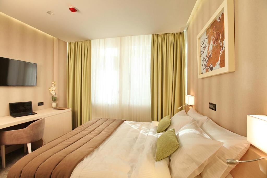Krevet ili kreveti u jedinici u okviru objekta Garni Hotel Argo