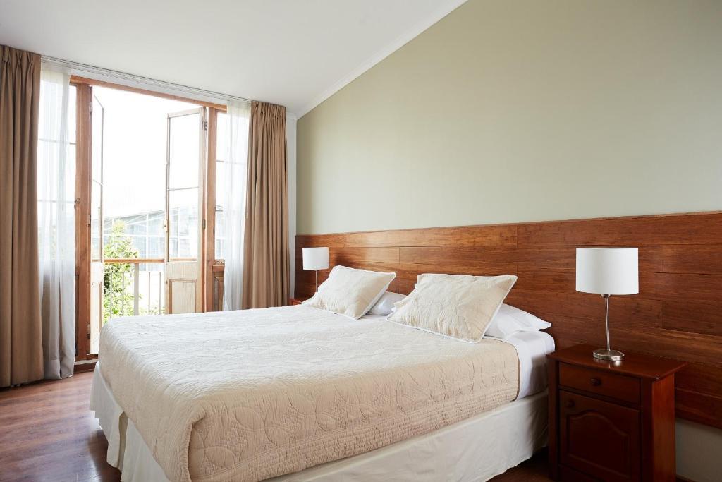 Cama ou camas em um quarto em Hotel Loreto