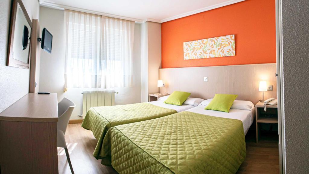 Cama o camas de una habitación en OK Hotel La Basílica