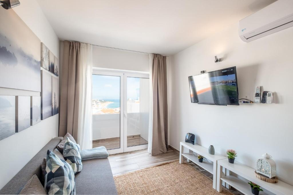 A television and/or entertainment centre at Oceanic Rainbow Apartment - Albufeira