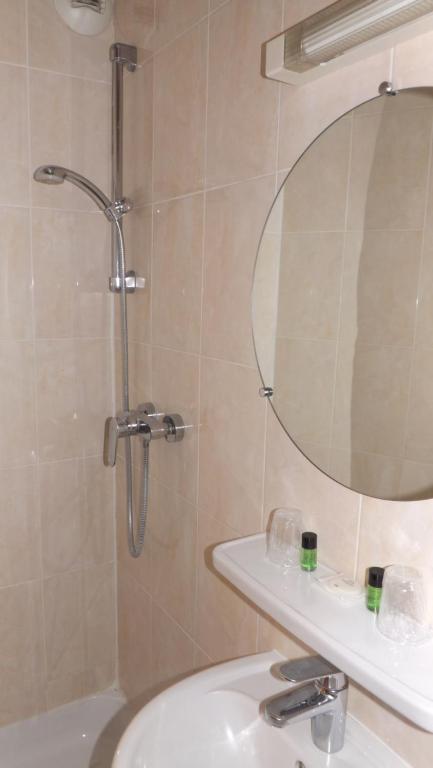 Ванная комната в Hôtel de la Place des Alpes
