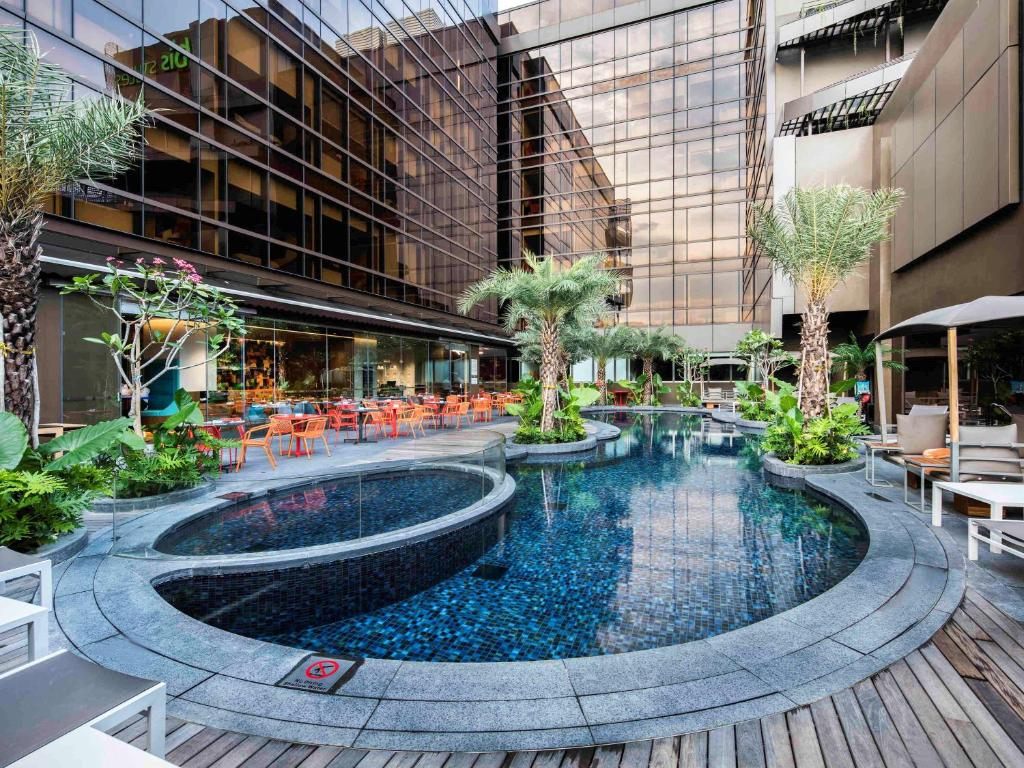 The swimming pool at or near Ibis Styles Singapore On Macpherson