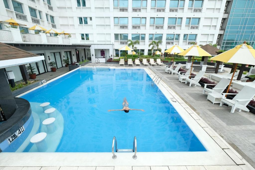 The swimming pool at or near Quest Hotel & Conference Center - Cebu