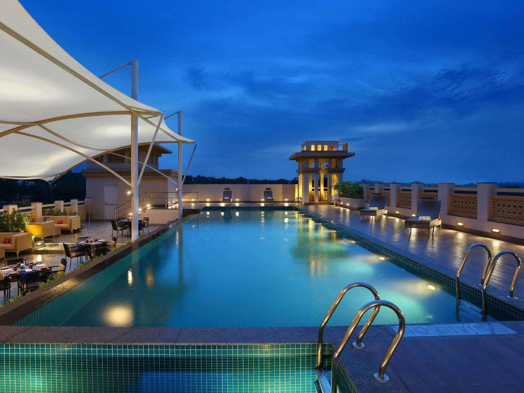 The swimming pool at or close to Grand Mercure Mysore - an AccorHotels Brand