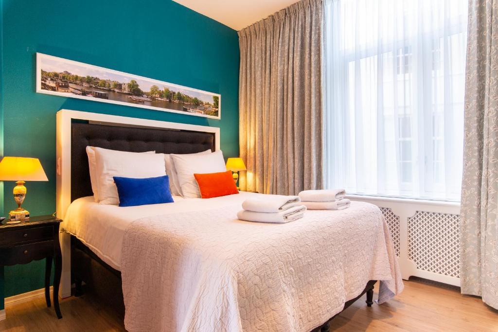 Een bed of bedden in een kamer bij B&B Blossom