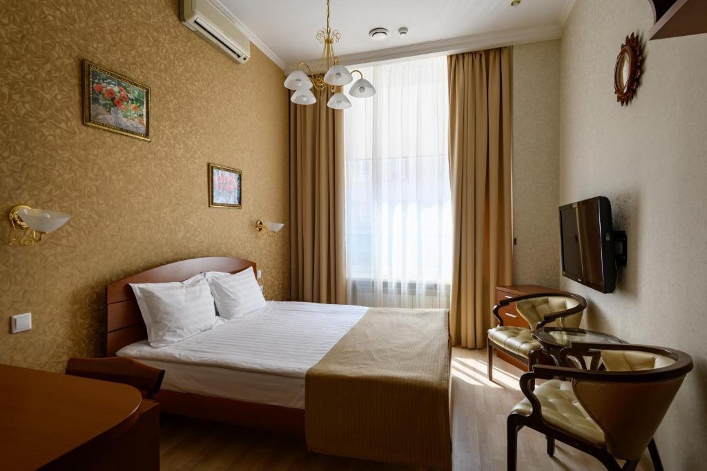 Кровать или кровати в номере Золотое Руно