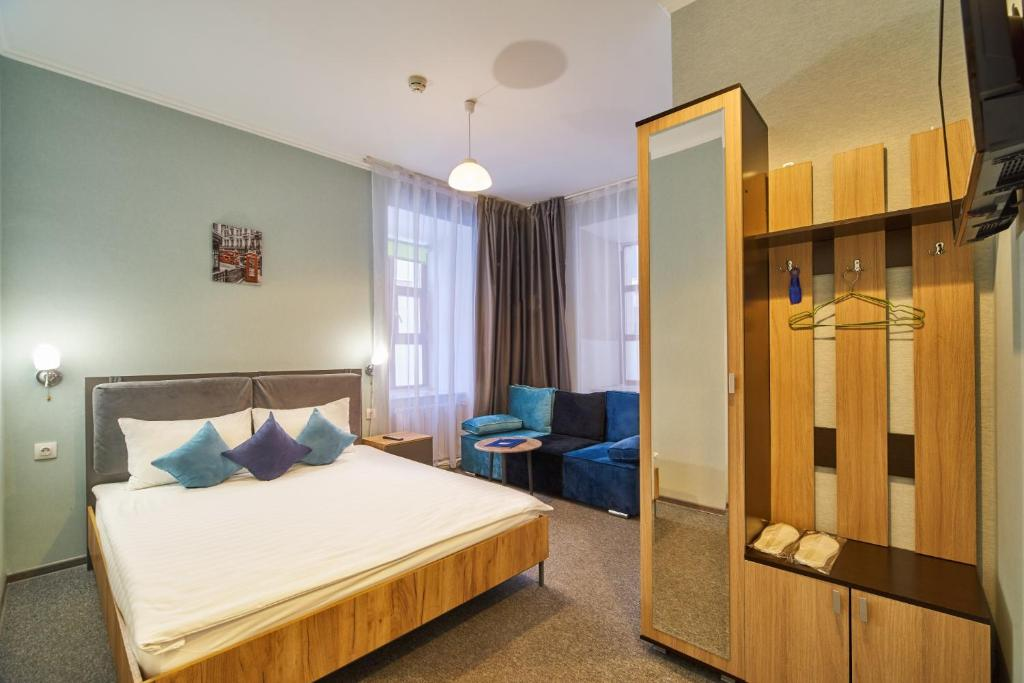 Кровать или кровати в номере Халва Отель Полянка