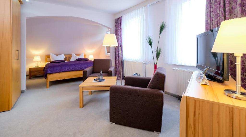 Ein Sitzbereich in der Unterkunft Hotel Riemann