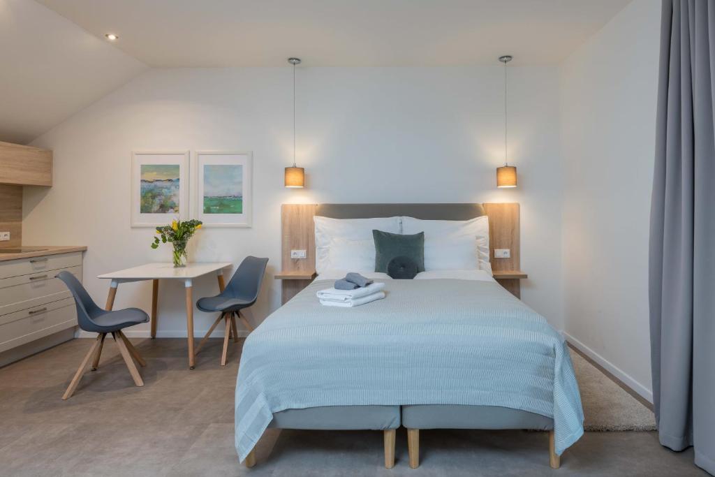 Postel nebo postele na pokoji v ubytování Statek u Prahy