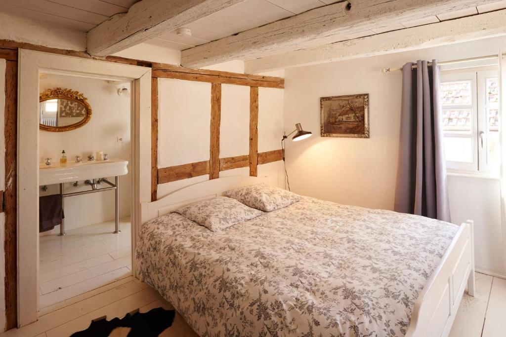 Un ou plusieurs lits dans un hébergement de l'établissement Un soir d'été - Chambres d'hôtes