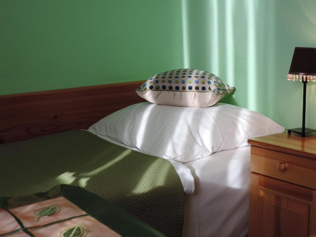 A bed or beds in a room at Burowianka