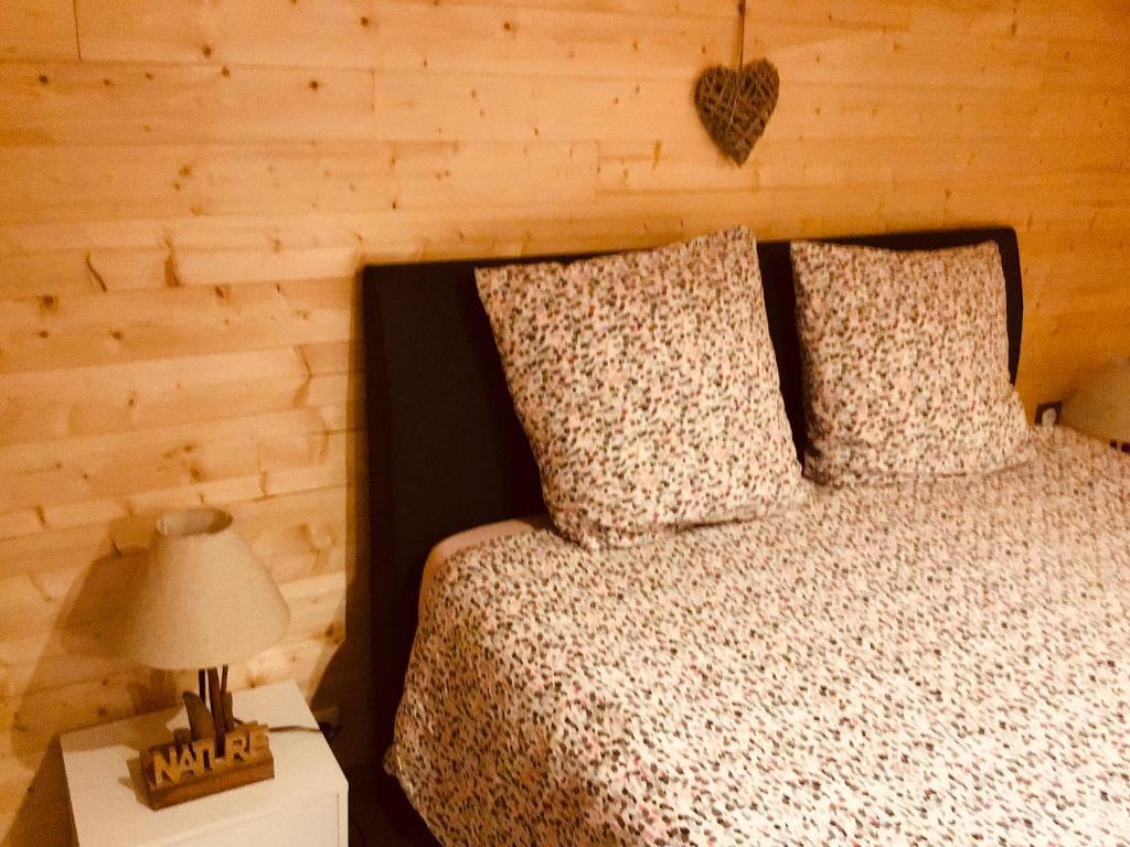 Un ou plusieurs lits dans un hébergement de l'établissement Le duplex De La Ferme Du Tertre