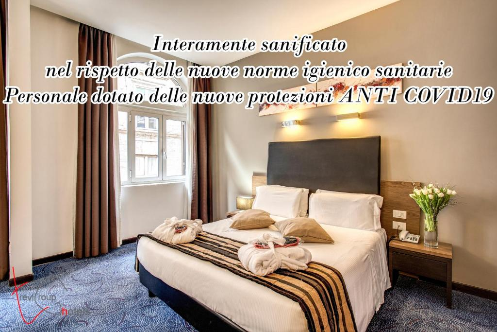A bed or beds in a room at Hotel Rinascimento - Gruppo Trevi Hotels