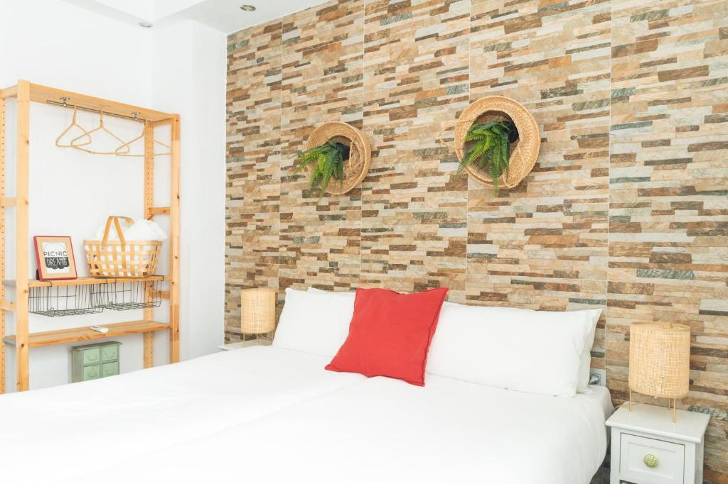 A bed or beds in a room at Picnic Dreams Boutique Hostel