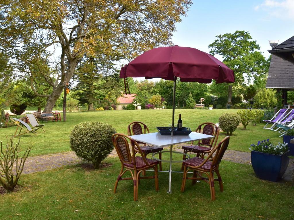 A garden outside Nice Holiday Home in Saint-Sauveur-Lendelin with Terrace