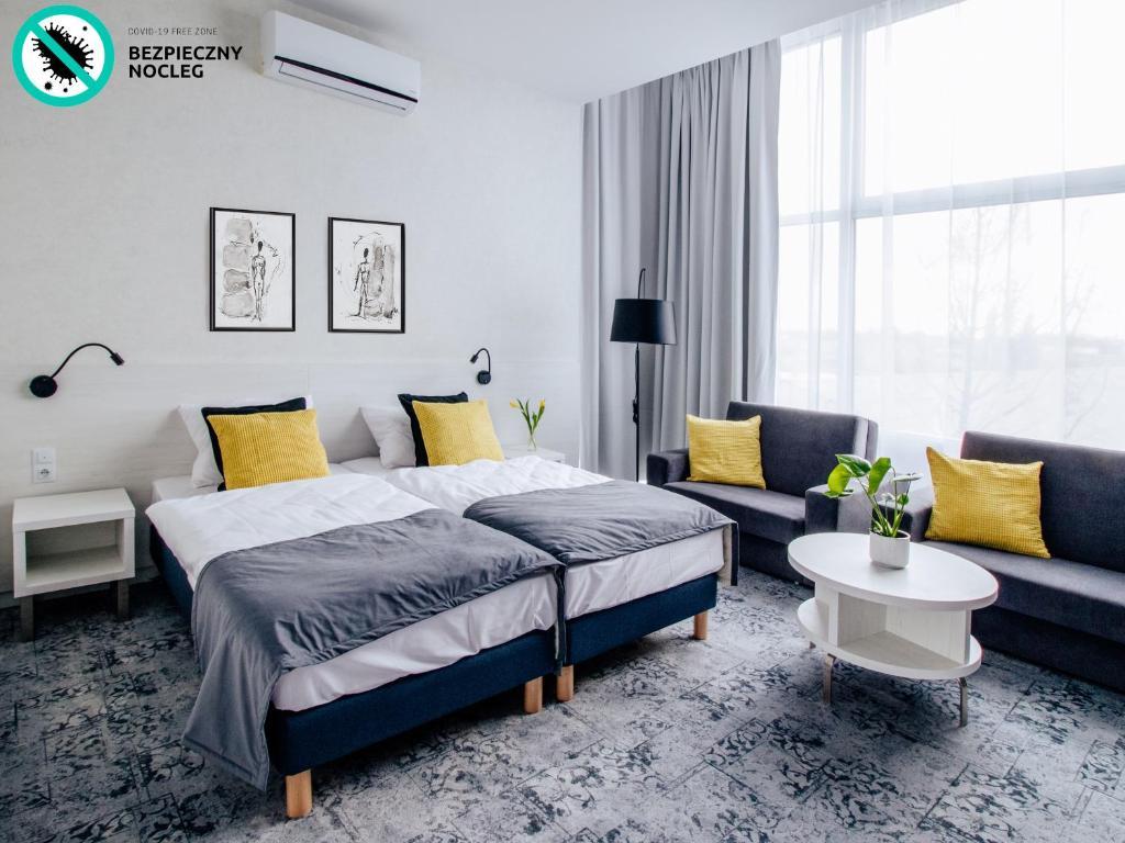 Łóżko lub łóżka w pokoju w obiekcie Pensjonat Absolwent