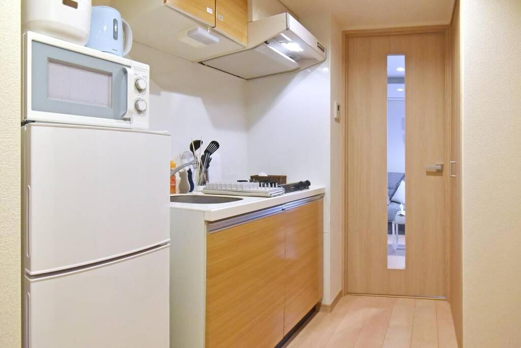A kitchen or kitchenette at IDstay大森301